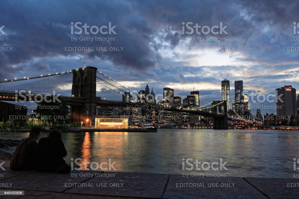 Brooklyn Bridge and New York skyline in cloudy evening stock photo