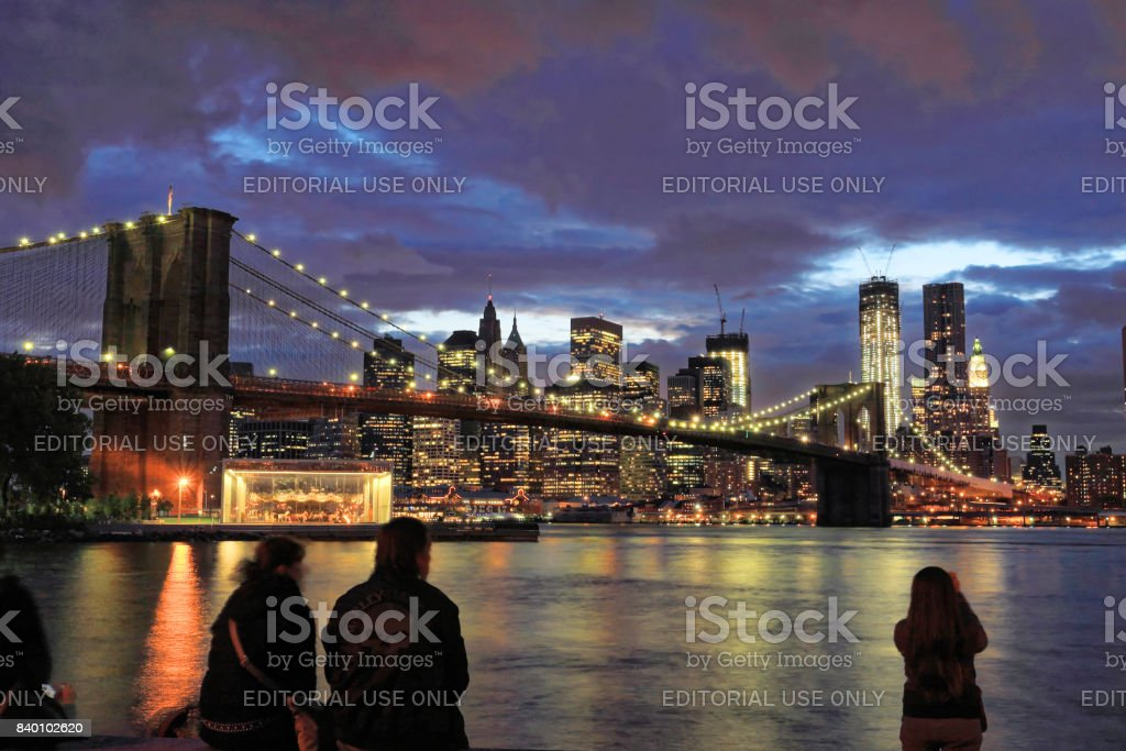New York, NY, USA - June 5, 2012: Brooklyn Bridge and New York skyline in cloudy evening stock photo