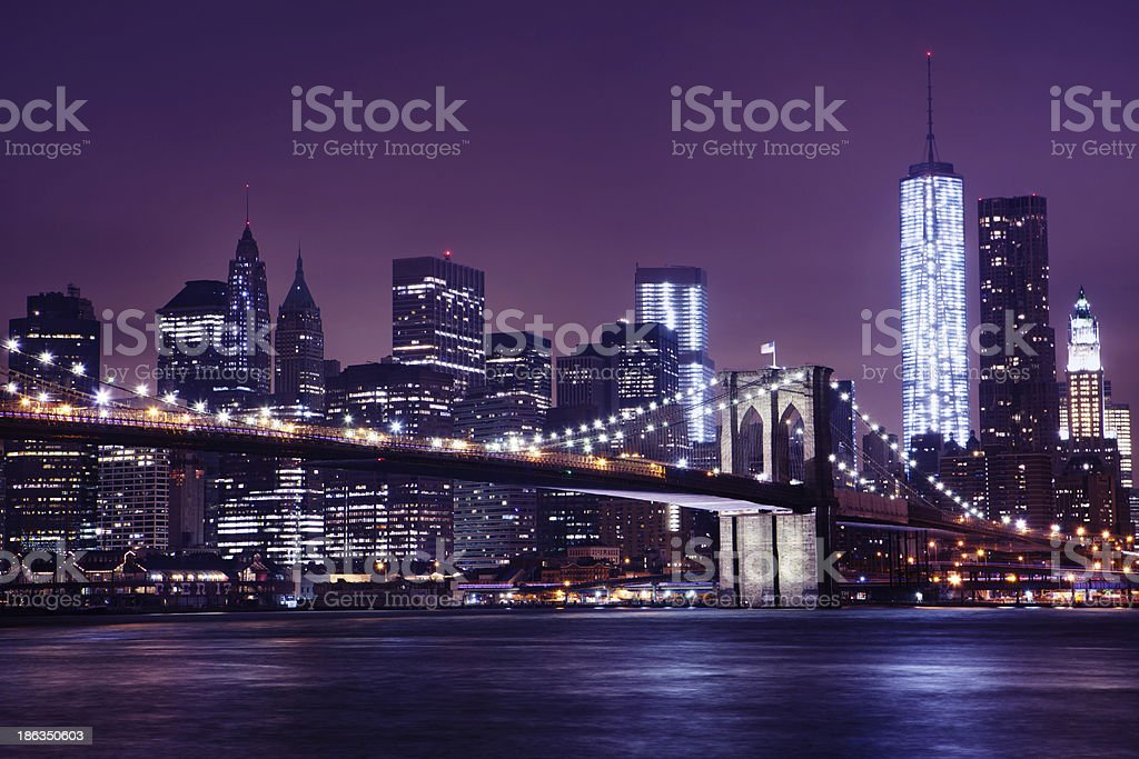 Brooklyn Bridge and One World Trade Center at Night stock photo