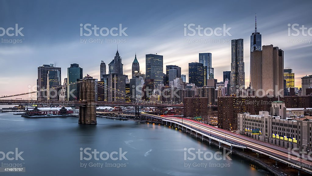 Brooklyn Bridge and the Financial District skyscrapers at dusk stock photo