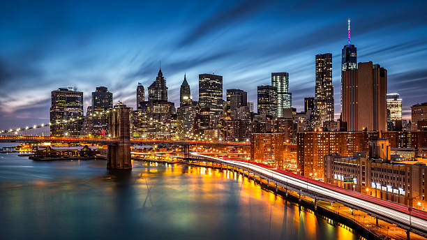 Brooklyn Bridge and the Lower Manhattan Brooklyn Bridge and the Lower Manhattan at dusk manhattan financial district stock pictures, royalty-free photos & images