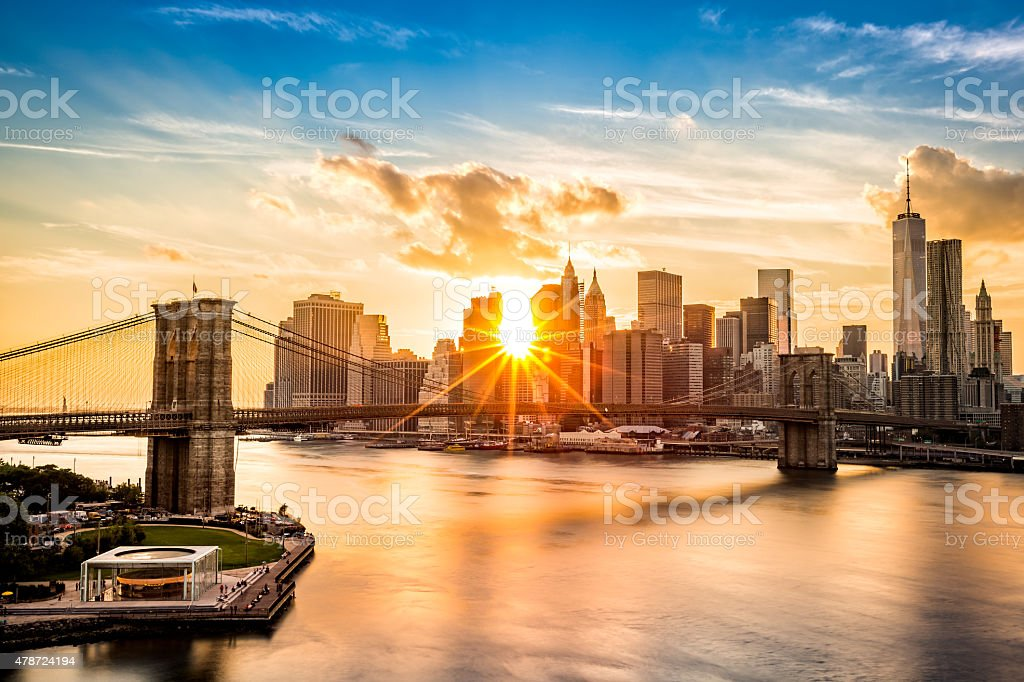 Brooklyn Bridge and the Lower Manhattan skyline at sunset stock photo