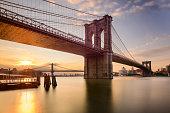 Brooklyn Bridge in New York City at sunrise.