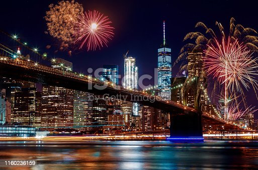 istock Brooklyn Bridge at dusk in New York City Colorful and vibrant fireworks 1160236159