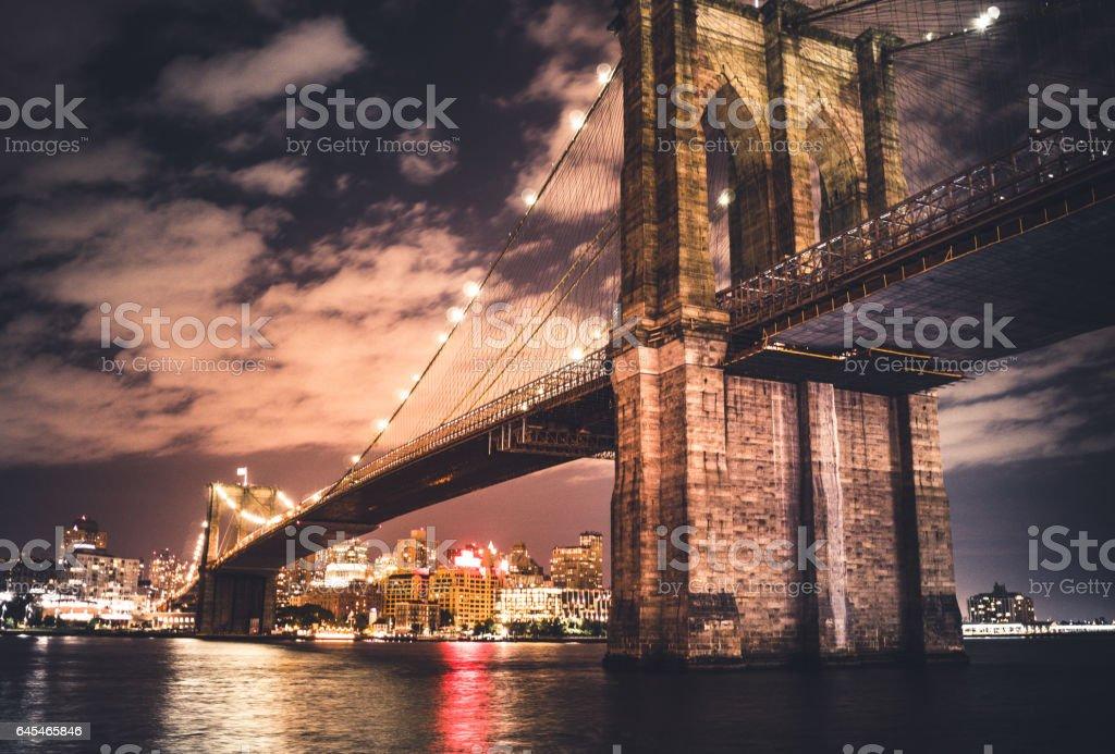 brooklyn bridge at night stock photo