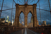 Brooklyn Bridge Early in the Morning, New York City. Beautiful Sunrise over this famous United States Landmark.