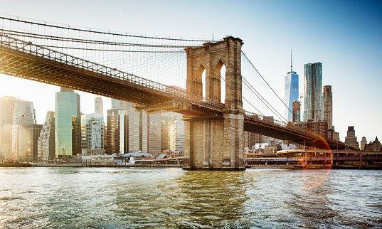 istock Brooklyn bridge from East river sunset with flare 500619014