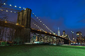 Brooklyn Bridge in Manhattan downtown with Cityscape at sunset New York USA