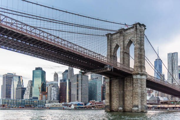 Brooklyn Bridge in New York City View over Lower Manhattan and the Brooklyn Bridge, from Brooklyn artistical stock pictures, royalty-free photos & images