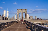 NEW YORK, USA - SEP 10, 1996: brooklyn bridge in New York with twin towers in background.