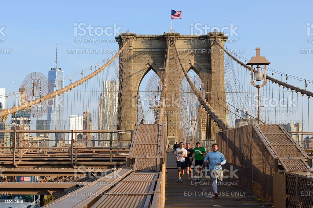 Brooklyn Bridge in the morning with runners royalty-free stock photo
