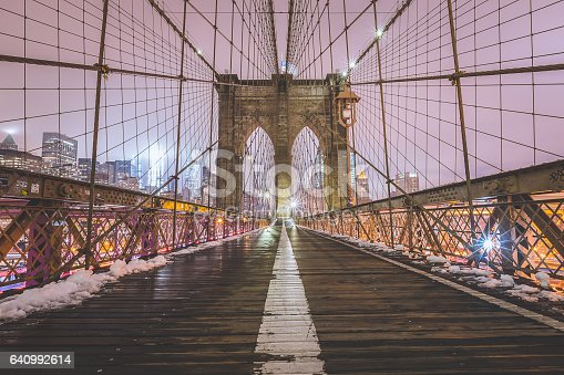 The empty Brooklyn Bridge on a snowy night