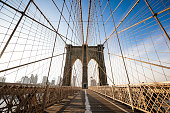 Horizontal wide-angle photo of the Brooklyn Bridge with no people on it at all during sunset which is extremely rare!