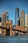 East River shoreline under the Brooklyn Bridge as seen from the DUMBO area in New York USA