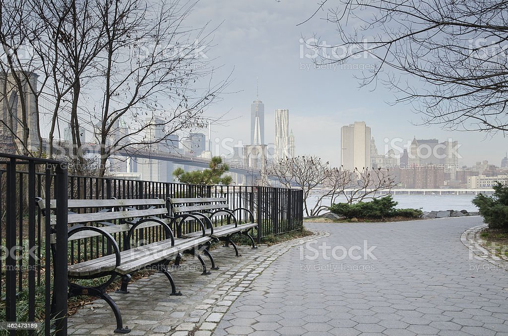 Brooklyn Bridge Park Bench and Walkway with Manhattan Skyline. stock photo