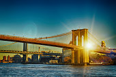 Two bridges of New York City at sunset time.