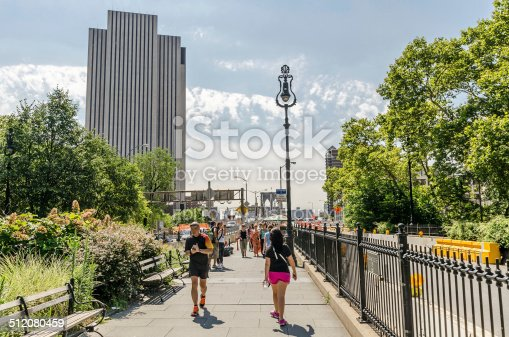 New York, USA - July 17,2014. People walk on Brookly Bridgre in New York City. The Brooklyn Bridge is a bridge in New York City and is one of the oldest suspension bridges in the United States.