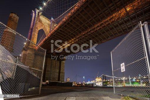 The Brooklyn Bridge, shot through an open gate. Brooklyn, NYC. USA.