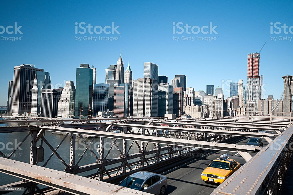 Brooklyn Bridge, Taxi Cabs, Manhattan and Blue Skies royalty-free stock photo