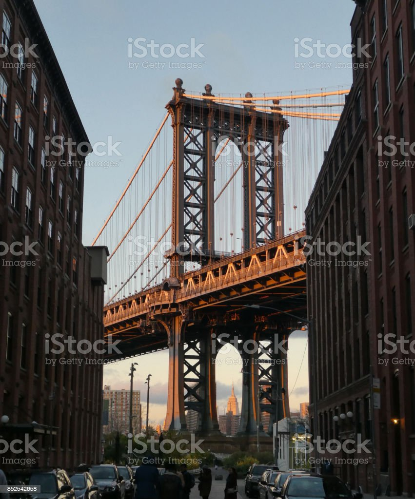 Brooklyn bridge with Empire State Building at sunset stock photo
