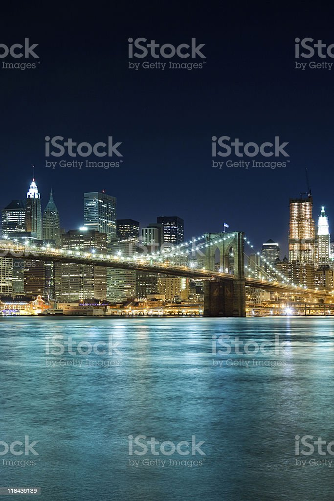 Brooklyn bridge with Manhattan buildings in background by night royalty-free stock photo
