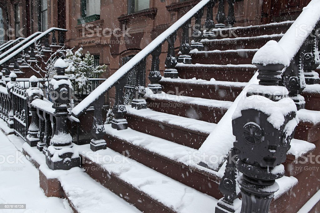 Brooklyn brownstone townhouse stoop in a winter snow storm stock photo