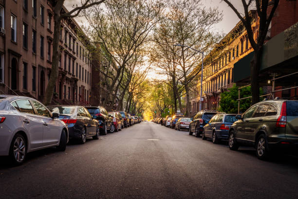 Brooklyn Brownstones and Cars on a Treelined Street stock photo