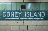 Green subway tile mosaic pointing towards Coney Island