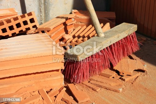 istock Broom and bricks on a construction site 177543766