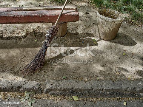istock Broom and bucket for cleaning garbage on the street. 826443408