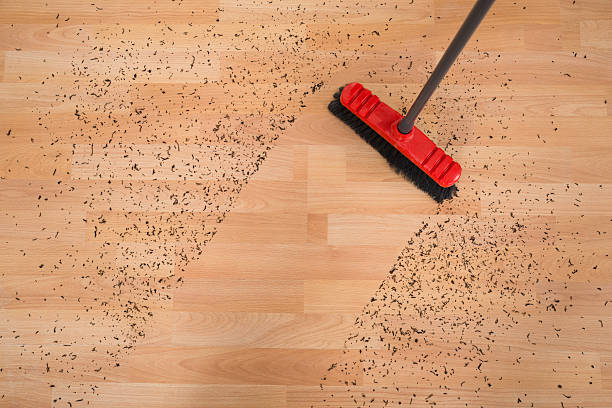 broom cleaning dirt on hardwood floor - sweeping stock pictures, royalty-free photos & images