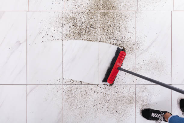 broom cleaning dirt on tiled floor - sweeping stock pictures, royalty-free photos & images
