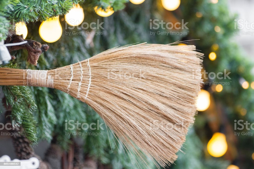 broom close up with pine branches and light bulbs royalty free stock photo - Christmas Broom Decoration