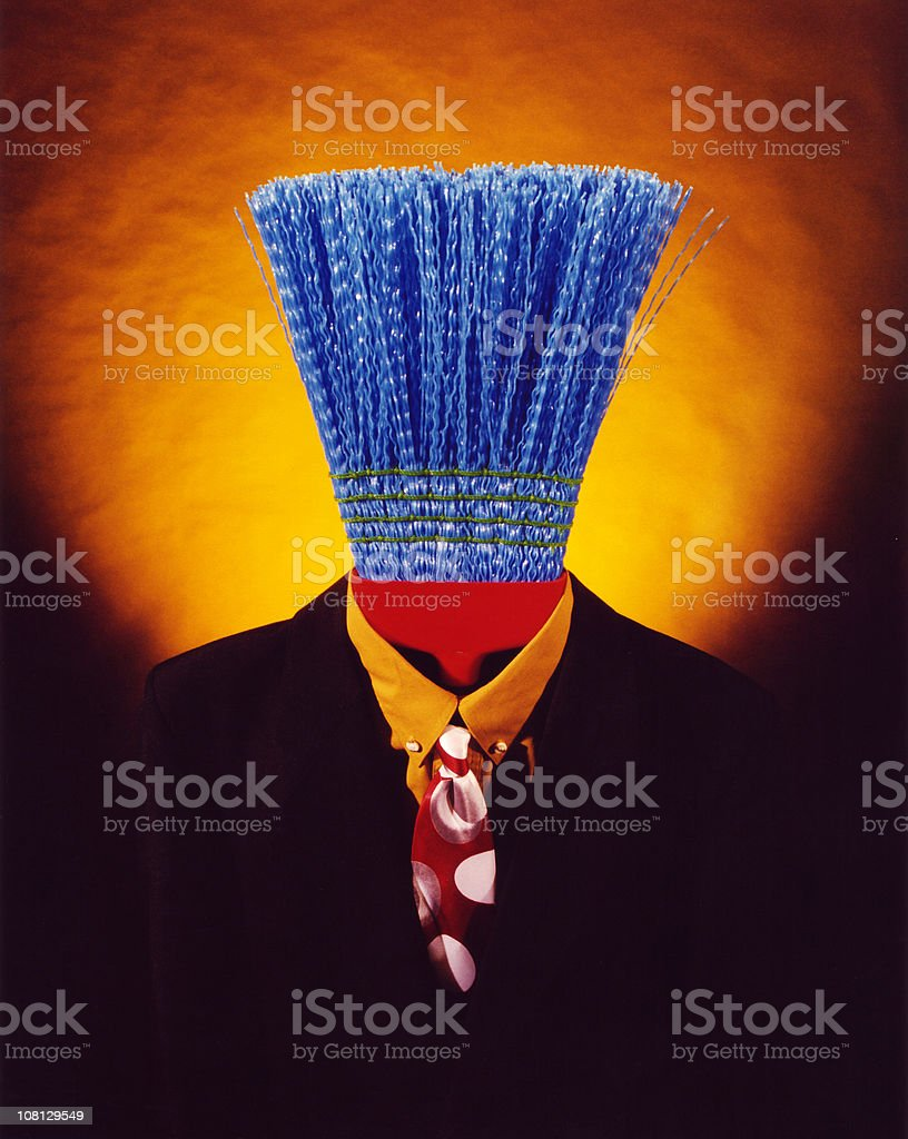 broom in suit - fashion royalty-free stock photo