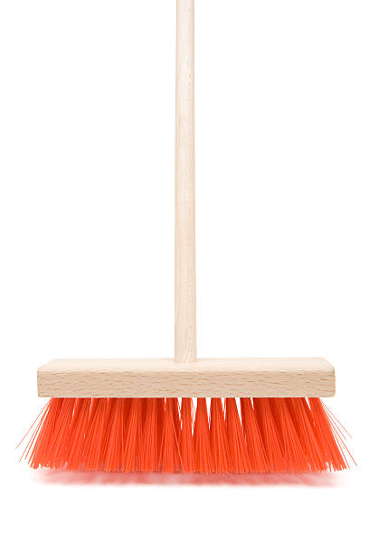 Broom Standing broom on a white background. broom stock pictures, royalty-free photos & images