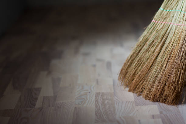 a broom stands on a wooden floor - sweeping stock pictures, royalty-free photos & images