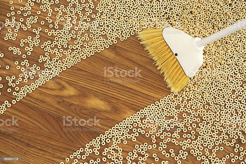 Broom Sweeping a Path Through Cereal stock photo