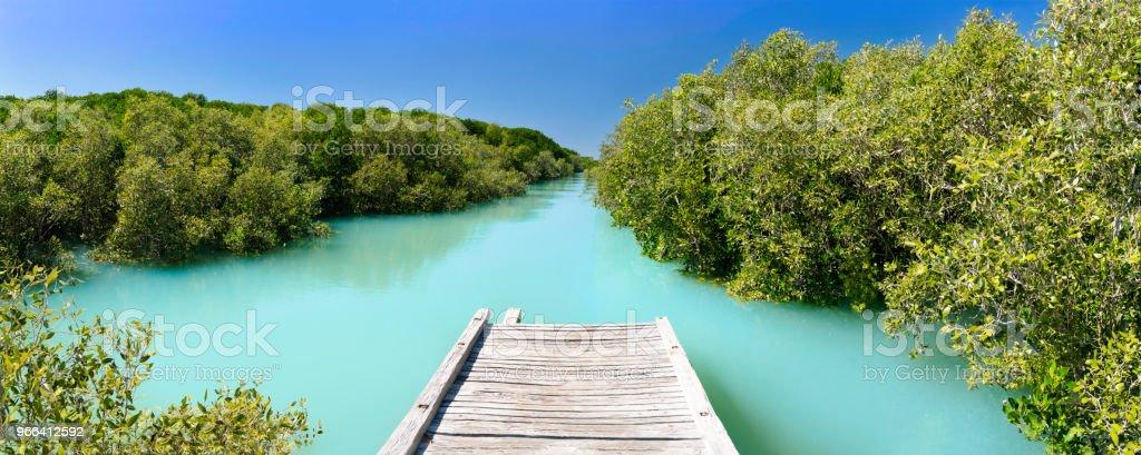 Broome town boardwalk high tide stock photo
