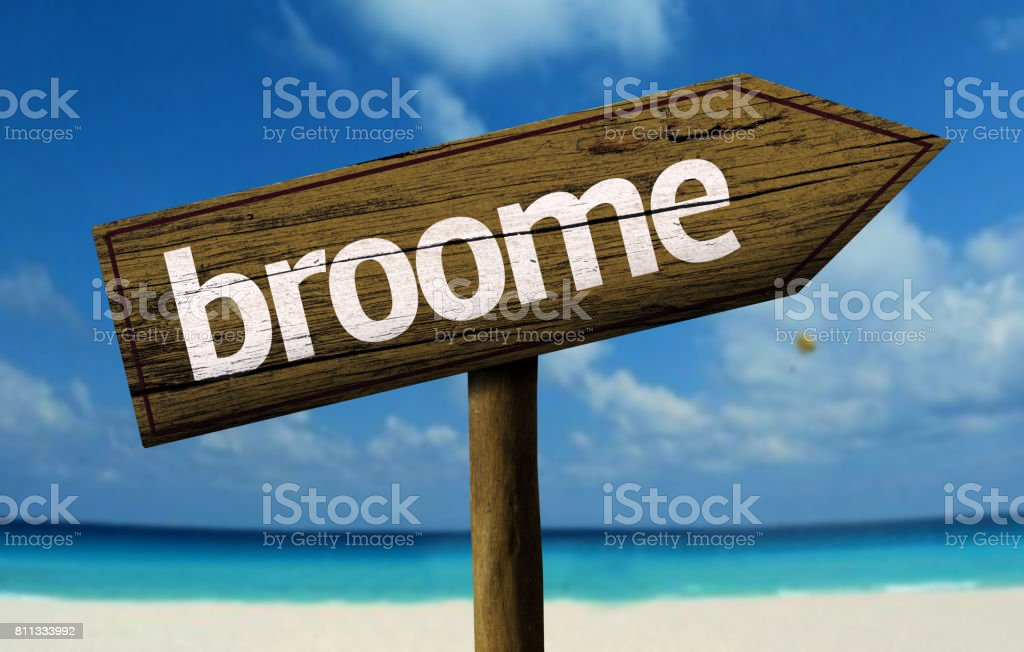 Broome wooden sign on the beach stock photo