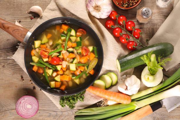 broth with vegetable, minestrone soup - minestrone foto e immagini stock