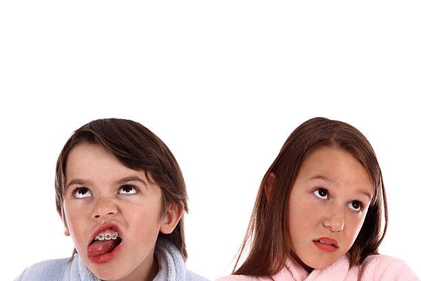 Brother And Sister Annoyed With Each other, Grimacing stock photo