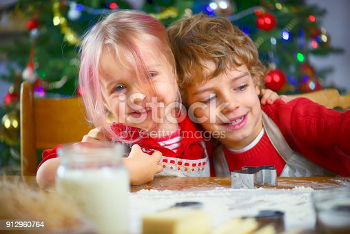 664420980 istock photo Brother and Sister Baking Cookies 912960764