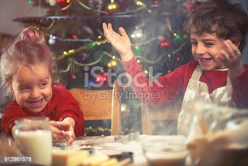 664420980 istock photo Brother and Sister Baking Cookies 912961578