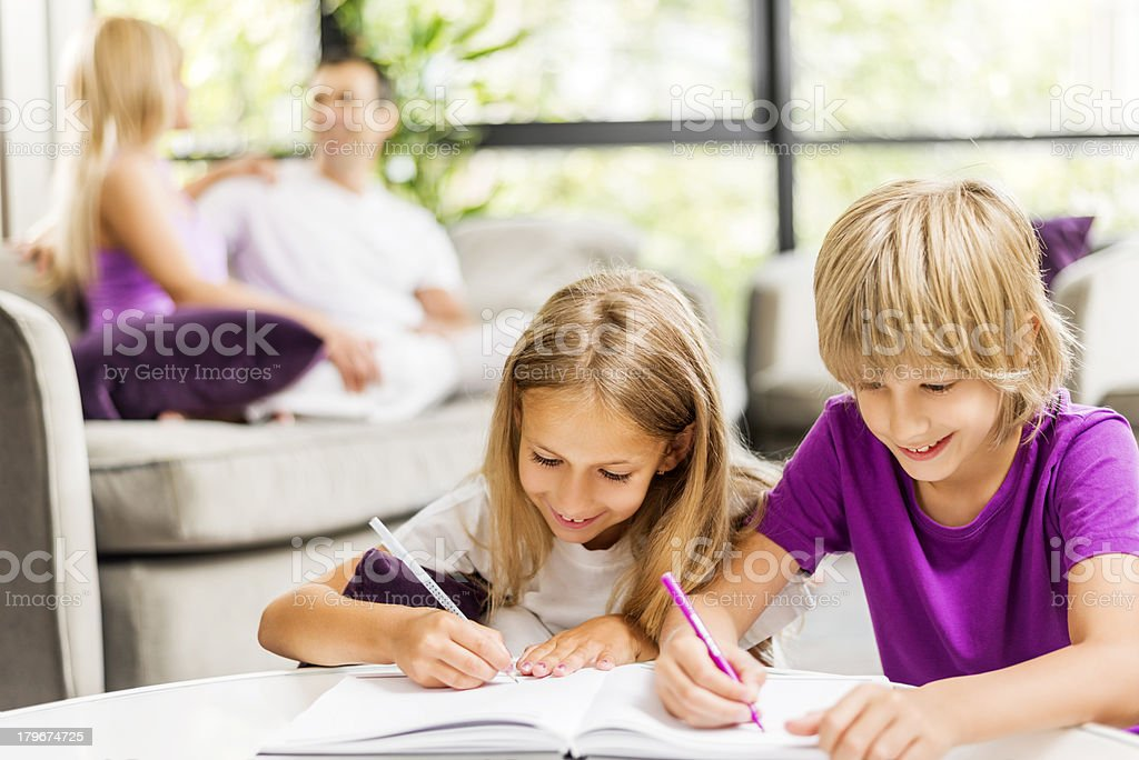 Brother and sister doing homework. royalty-free stock photo