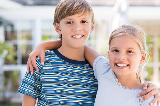 Brother and sister embracing stock photo