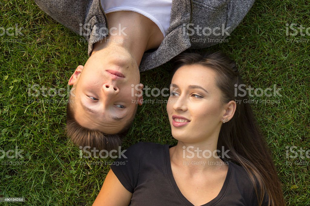 Brother And Sister Funny Expressions Laying In Grass Stock Photo