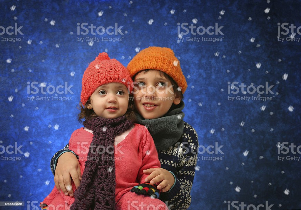 Brother and sister having fun in winter royalty-free stock photo