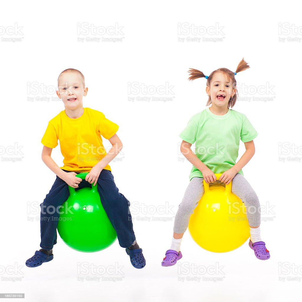 brother and sister heaving fun with bouncing ball stock photo