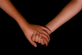 big sister holding her little brothers hand, loving and caring photo, colour image isolated on a black background