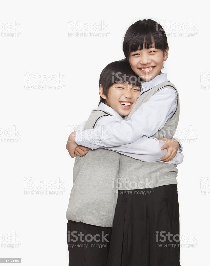 Brother and sister hugging stock photo